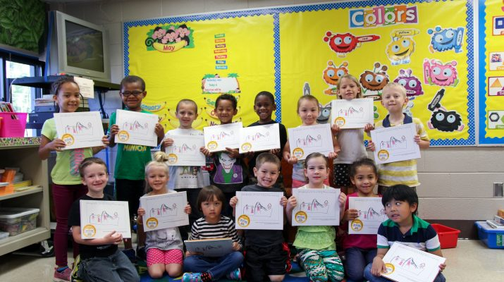 Mrs. Freyberger's class holding up books